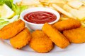 Chicken nuggets with french fries and ketchup Royalty Free Stock Photo