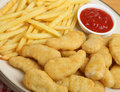 Chicken nuggets with fries fried and tomato ketchup Stock Image