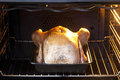 Chicken in oven Stock Photo