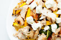 Chicken pasta penne primavera a delicious heart healthy vegetable and dish topped with fresh goat cheese Stock Images
