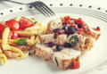 Chicken and pasta a plate of grilled with vegetables Royalty Free Stock Image