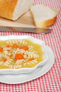 Chicken pasta soup with sliced bread Stock Photo