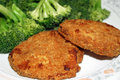 Chicken patties and broccoli crispy breaded with fresh Stock Images