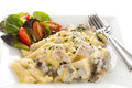 Chicken penne pasta delicious creamy with a garden salad Stock Photo