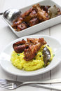 Chicken and pork adobo over yellow rice, filipino food Royalty Free Stock Photo