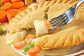 Chicken pot pie closeup of a forkful of with ingredients Royalty Free Stock Photography