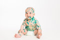 Chicken pox ailing infant on white background and smiling sitting Royalty Free Stock Photos