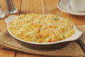 Chicken rice casserole with vegetables on a rustic wooden table Stock Photography