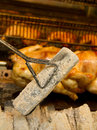Chicken roasting whole over coals Stock Images