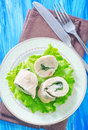 Chicken roll with spinach on plate Stock Image