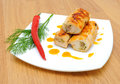 Chicken rolls, chili and dill twig on a plate Royalty Free Stock Image