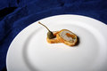 Chicken roulade and an olice in a plate Royalty Free Stock Photo
