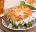 Chicken salad on croissant roll lettuce a Stock Photos