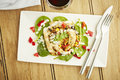 Chicken salad on white dish and wooden table top Royalty Free Stock Photo