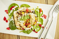 Chicken salad on white dish and wooden table top Royalty Free Stock Images