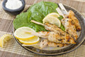 Chicken satay char grilled mini fillet skewers served with lemon and aioli dip Stock Images