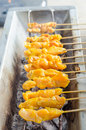 Chicken satay on grill bar Royalty Free Stock Photography