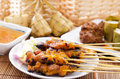 Chicken satay and ketupat or malay rice dumpling lemang rendang traditional malay food ramadan dish malaysian cuisine Stock Photos