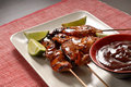 Chicken satay with limes Royalty Free Stock Images