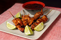 Chicken satay and limes Stock Photo