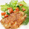Chicken schnitzel with vegetables and herbs Royalty Free Stock Image
