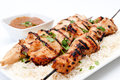 Chicken skewers grilled on bamboo with a peanut dipping sauce Royalty Free Stock Image