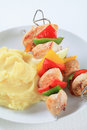 Chicken skewers with mashed potato Stock Photos