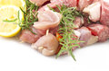 Chicken skewers and rosemary close up on white Royalty Free Stock Images