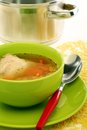 Chicken soup in a green bowl. Stock Photography