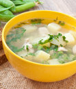 Chicken soup with green peas in a bowl Royalty Free Stock Images