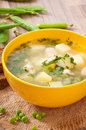 Chicken soup with green peas in a bowl Royalty Free Stock Photography
