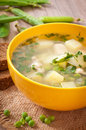 Chicken soup with green peas in a bowl Stock Images