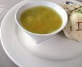 Chicken soup a hot bowl of with a wrap for lunch Royalty Free Stock Image