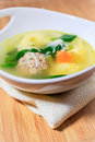 Chicken soup with meatball and tortellini a make tortelli pasta celery baby spinach Stock Photos