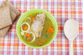 Chicken soup plate of on the tablecloth Stock Images