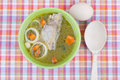 Chicken soup plate of on the tablecloth Royalty Free Stock Images