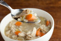 Chicken soup spoonful close up of a of fresh homemade traditional shallow depth of field Stock Image