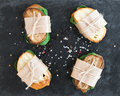 Chicken and spinach sandwiches wrapped in craft paper Royalty Free Stock Photo