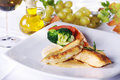 Chicken steak with garnish on plate Stock Photography