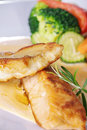 Chicken steak with garnish on plate Royalty Free Stock Photography