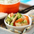 Chicken stir fry with vegetables and rice carrots onions broccoli green beans Royalty Free Stock Images