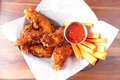 Chicken strips tenders or with a spicy chilli sauce and vegetable sticks Stock Photos