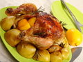 Chicken stuffed with lemons, apples and rosemary. Royalty Free Stock Photo