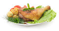 Chicken thigh with vegetables on a platter Royalty Free Stock Photo