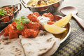 Chicken Tikka Masala with Chapati and Rice Pilau Stock Photos