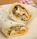 Chicken tikka wrap sandwich with yoghurt and mint dressing Stock Photos