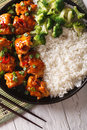 Chicken tso in sauce with rice and broccoli closeup. vertical to Royalty Free Stock Photo