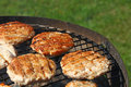 Chicken or turkey burgers for hamburger on grill Royalty Free Stock Photo