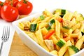Chicken and veggie pasta salad bowl of with vegetables Stock Images