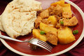 Chicken vindaloo curry goan and potato cooked in a vinegar and spice sauce and served with a slice of flat bread Royalty Free Stock Images